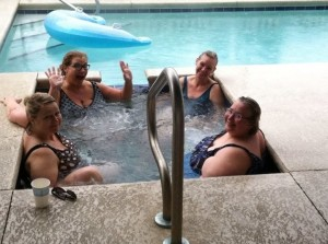 Janice Kaye, Julia Bailey, Angela Dancho, Lynda Finn relax in the hot tub