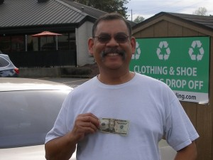 James Johnson in the parking lot with his winnings