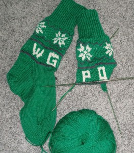 These socks, when completed, will be in the silent auction