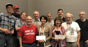 Division 1 winners posed with Bennett and Dave.   Kevin Fraley won 23 games and the cup (was Gibsonized in the last round), Joe Gaspard was second, Jon Shreve third (and had high game with a 707), Yukiko Loritz had high loss, David Goldberg was fourth, Maddy Kamen sixth, James Davis won second-place performance prize, Keith Hagel had the best ratings performance, Ron Tiekert finished fifth.